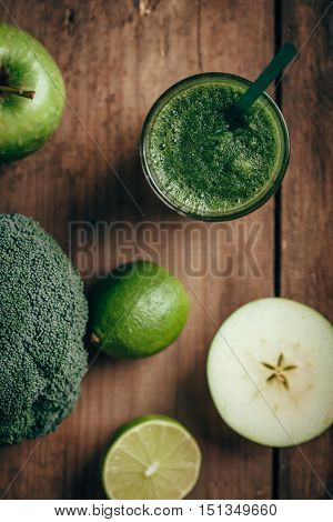 Overhead view of fresh green smoothie from fruit and vegetables, healthy eating, selective focus. Apple. lime, broccoli