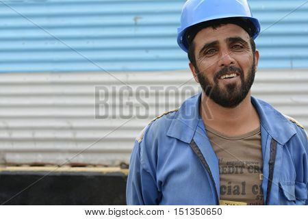 Tehran IRAN - June 6 2016 Laughing Afghanistanian construction workman at building site in Tehran