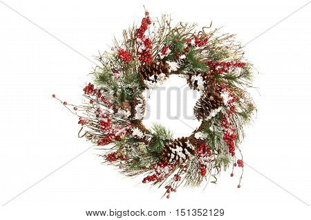 Christmas Wreath with Red Berries and Pine with A Little Snow