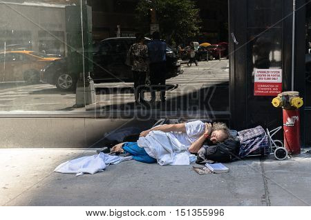 New York USA - September 20 2015: Homeless man sleeps on the street of New York.