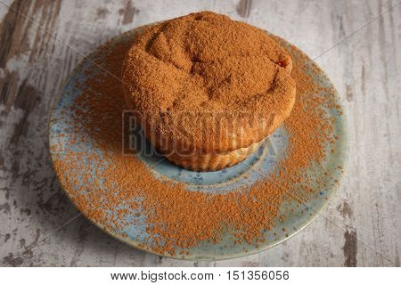 Fresh Muffins With Powdery Cinnamon On Wooden Background, Delicious Dessert
