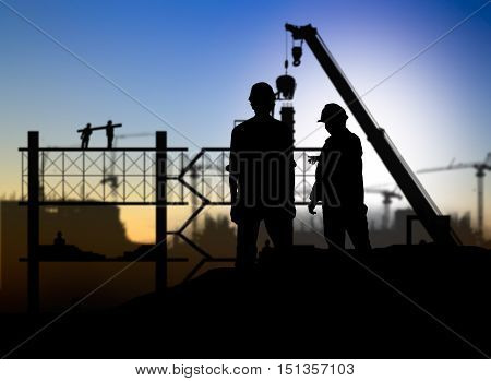 silhouette engineer looking construction worker in a building site over Blurred construction site
