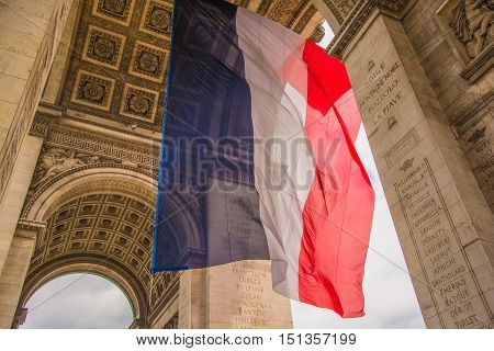 The French flag in the Arc de Triomphe in Paris, France