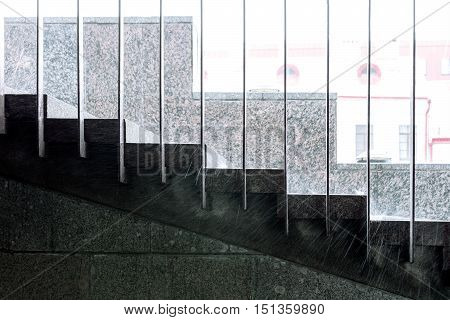 Raindrops On Staircase During Downpour. Heavy Rain In City.