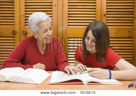 Grandmother Helping Her Granddaugther With Homework