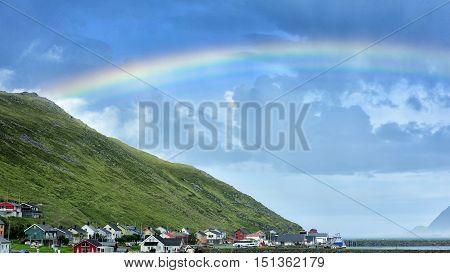 rainbow over Skarsvag village in the coast of RisfjordenNorway