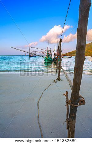 Seascape with fishermen's colourful boats on the sandy beach. Thailand.