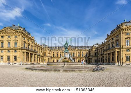 Wurzburg Germany - May 22 2016: Wurzburg Residence palace and statue Frankonia fountain in the foreground at Wurzburg Germany. The Wurzburg Residence was inscribed in the UNESCO World Heritage List in 1981.