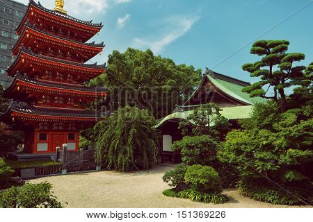 Fukuoka - July 2016: Tochoji shrine graden with pagoda.