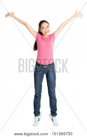 Portrait of young Asian girl in pink shirt and jeans arms outstretched, full body standing isolated on white background.