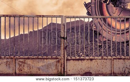 Giant bucket wheel excavator for digging the brown coal behind an iron gate