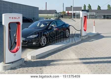 Aarhus, Denmark - September 14, 2016: Tesla Car Being Charged At Supercharger
