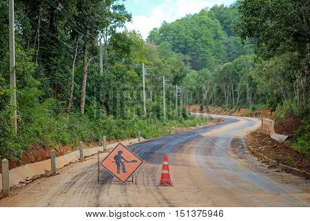 The road in forest is currently under construction.