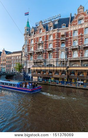 Amsterdam, Netherlands - April 3, 2008: Luxury Hotel Europe And The Boats