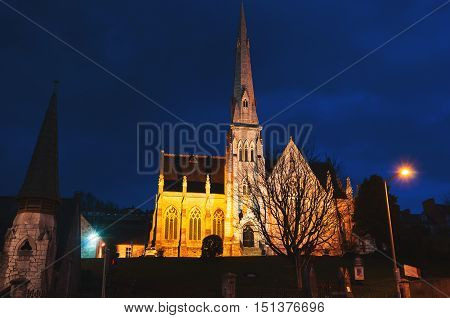 Trinity Presbyterian Church in Cork Ireland at night. Dark blue sky