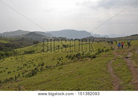 Group tourists making a trek in Simion mountains Ethiopia. Simion National Park; Ethiopia - September 29; 2012: Group of tourists making a trek in Simien National Park. This area is very interesting for hiking for of outstanding rugged scenery and extreme