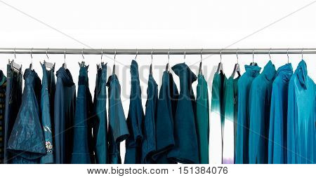 Set of female blue dress and trousers, coat ,sundress  isolated on hanging