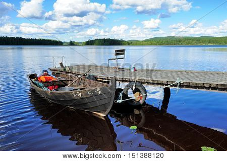 old wooden boat for fishing in a lake