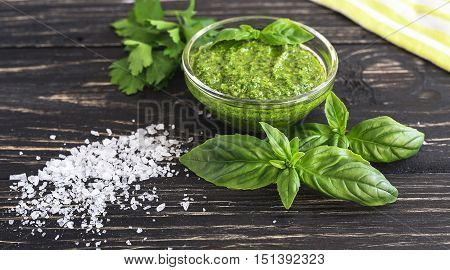 Pesto Sauce In Glass Jar, Sea Salt And Basil Leaves