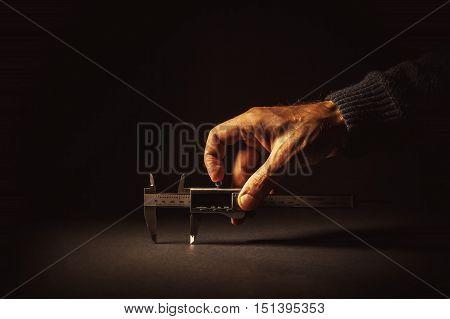 Male Hand Holding A Vernier Caliper