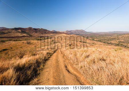 Dirt road trail across ridge in scenic wilderness landscape