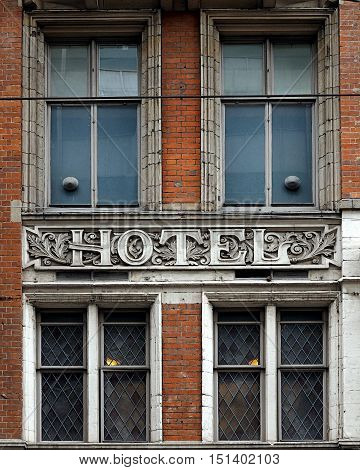 Carved vintage stone hotel sign and windows