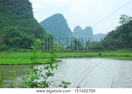 The karst mountains and rural scenery in spring, Guilin, China.