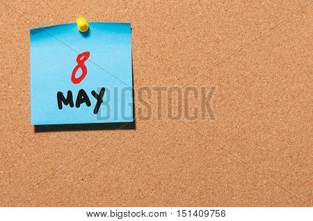 May 8th. Day 8 of month, calendar on cork notice board, business background. Spring time, empty space for text.