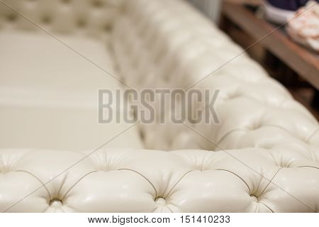Ivory armrest of a luxury leather couch