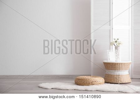 Room interior with white decorations and wicker furniture