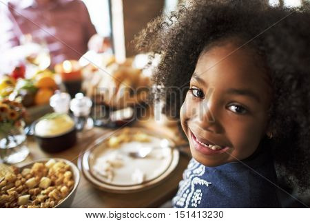 Little Girl Eating Thanksgiving Celebration Concept