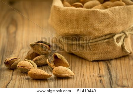 Almonds on brown wooden background. Beneficials for the brain