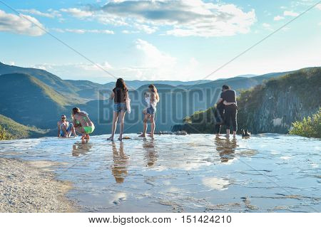 Oaxaca Mexico - November 15 2014: Young people pose for photos and chill in the pools of the Hierve el agua hot springs in the state of Oaxaca Mexico