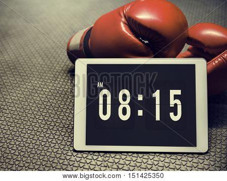 Boxing Glove Digital Tablet Morning Alarm Training Concept