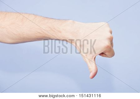 Hand Showing Thumb Down Sign