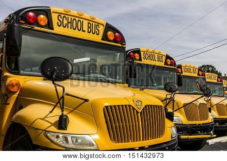 Kokomo - Circa October 2016: Yellow School Buses in a District Lot Waiting to Depart for Students I
