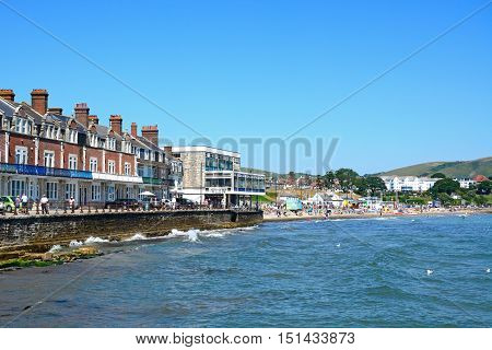SWANAGE, UNITED KINGDOM - JULY 19, 2016 - View along the beach and promenade with holidaymakers enjoying the setting Swanage Dorset England UK Western Europe, July 19, 2016.