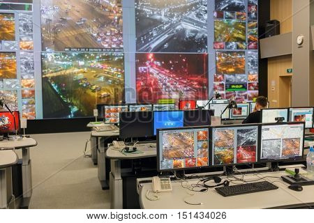MOSCOW, RUSSIA - FEB 04, 2016: room with lot of firm monitors nec with online video broadcast traffic conditions on city streets