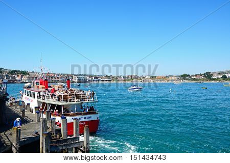 SWANAGE, UNITED KINGDOM - JULY 19, 2016 - Solent Scene ship with tourists moored along the jetty with views of the town to the rear Swanage Dorset England UK Western Europe, July 19, 2016.