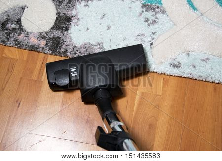 photo of a vacuum cleaner on the floor