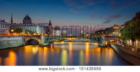 Paris Panorama. Panoramic image of Paris riverside during twilight blue hour.