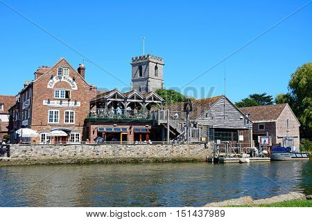WAREHAM, UNITED KINGDOM - JULY 19, 2016 - View across the river towards The Old Granary and Lady St Mary church Wareham Dorset England UK Western Europe, July 19, 2016.
