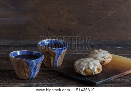 eclairs on a clay board coffee and dessert eclairs and coffee