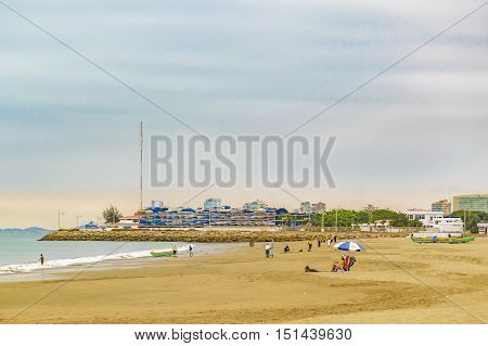 SALINAS, ECUADOR, OCTOBER - 2015 - People at Playa de Chipipe beach in Salinas Ecuador