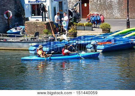 WAREHAM, UNITED KINGDOM - JULY 19, 2016 - Couple with a dog in a canoe of the river Wareham Dorset England UK Western Europe, July 19, 2016.