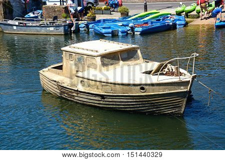 WAREHAM, UNITED KINGDOM - JULY 19, 2016 - Muddy boat recovered from the riverbed along the river Wareham Dorset England UK Western Europe, July 19, 2016.