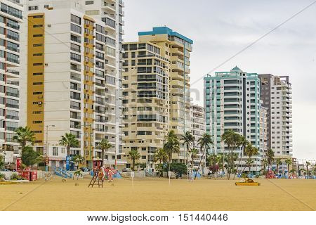 SALINAS, ECUADOR, OCTOBER - 2015 - Modern apartments buildings in front of beach at Playa de Chipipe Salinas Ecuador