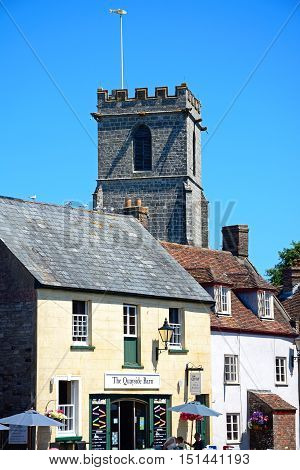 WAREHAM, UNITED KINGDOM - JULY 19, 2016 - The Quayside Barn bed and breakfast with Lady St Mary church tower to the rear Wareham Dorset England UK Western Europe, July 9, 2016.