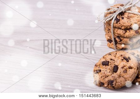 Winter Background - Freshly Baked Chocolate Chip Cookies And Copy Space On Wooden Background