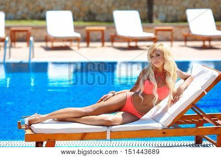 Beautiful Sexy Woman Bikini Model Tanned And Lying On Deck Chair By The Blue Swimming Pool,summer Va
